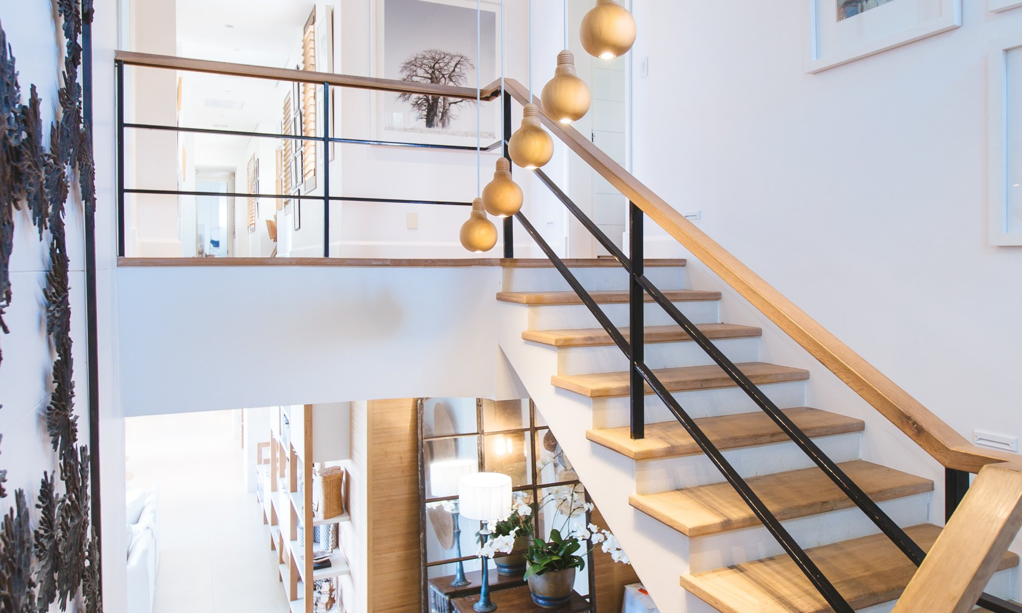 Modern u-style wood staircase in white background
