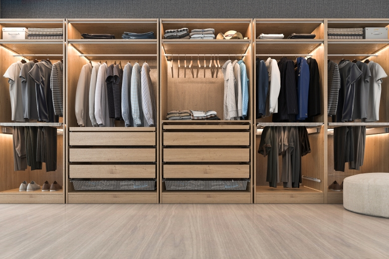 modern scandinavian white wood walk in closet with wardrobe near window