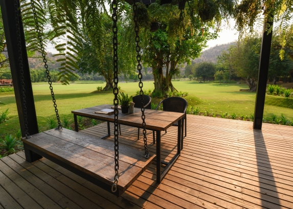 Wooden chair with table on patio